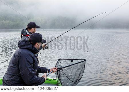 Ukraine, Dniester - 11 June 2021.dniester Grand Canyon.two Fisherman On Boat.zander Fishing. Walleye
