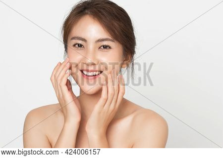Beautiful Asian Woman Happy Touching Her Skin Facial Face Care On White Background. Beauty Female Wi