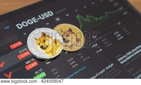 Bangkok, Thailand - June 16, 2021: Dogecoin Doge Coin Cryptocurrency, Digital Crypto Currency Tokens