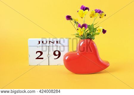 Calendar For June 29 : The Name Of The Month Of June In English, The Number 29 On Cubes, A Vase In T