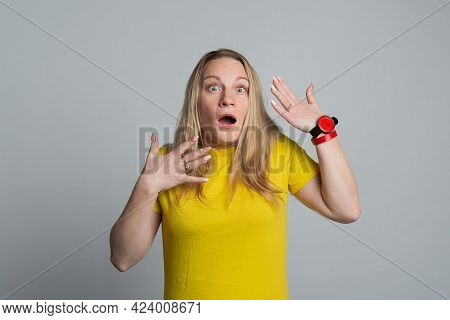 Mature Woman Looking Unpleasantly Shocked, Scared Or Worried With Mouth Wide Open, Wearing Casual Ye