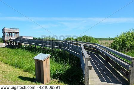 Riga, Latvia - June 16, 2011: Wooden Building House Viewpoint Place In The Nature With Blue Sky And