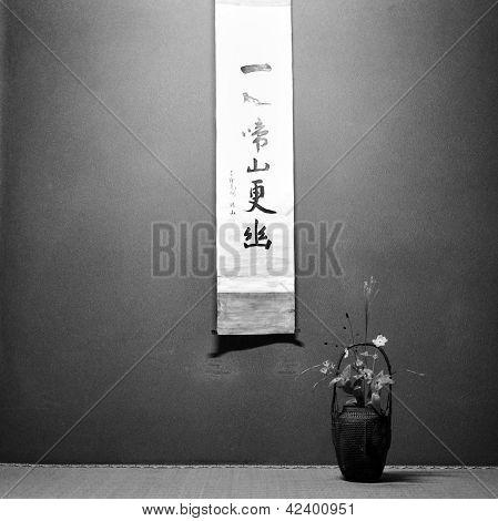 Ikebana On Table With Japanese Catchphrase