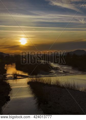 Winter Sunset With Mist Over River Serchio Near The City Of Lucca
