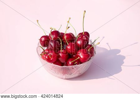Juicy Fresh Cherries Or Cherries In A Glass Bowl On A Pink Background. Summer Berries And Fruits. Pl