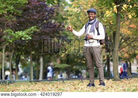 Portrait Of Handsome Happy Young Black African Afro American College Or University Student Guy With