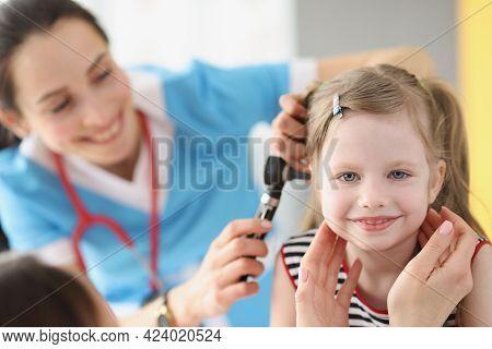 Child With Otitis Media Attending Pediatric Otolaryngologist At Hospital