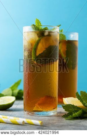 Summer Refreshing Drink, Two Glasses With Iced Fruit Tea With Mint Leaves And Lemon