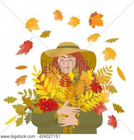A Pretty Girl Holds A Bouquet Of Autumn Leaves Of Mountain Ash, Maple And Oak Against The Background