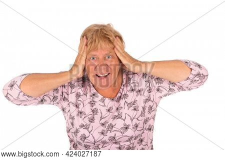 Portrait surprised blonde senior woman on white background