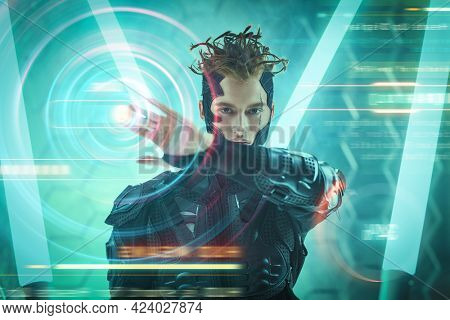 ?yberpunk warrior touches digital hologram in neon light. The world of the future. Game, virtual reality.