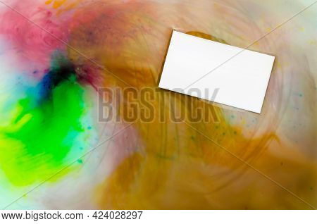 Blank White Business Card On A Multicolored Abstract Background. Rectangular Business Card Floating