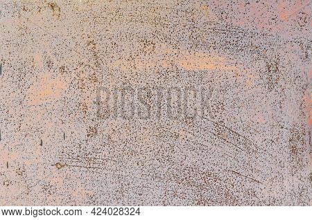 Dots And Spots Of Rust On The Red Painted Metal Wall.  Bloated Peeling Cracked Paint. Corroded Metal