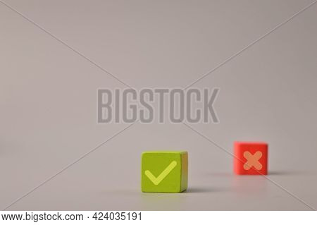 Wooden Blocks With Check Mark And X Symbols On Wooden Blocks. Correct And Wrong Concept.
