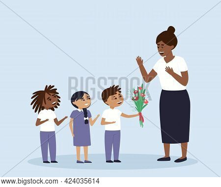Children Give Flowers To Their Teacher Or Educator. International Boys And Girls Prepared A Bouquet