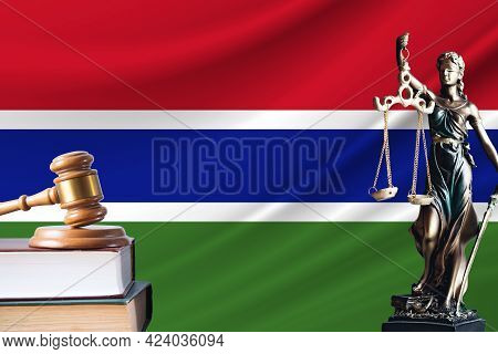 Law And Justice In Gambia. Statue Of Themis And The Gavel Of The Judge Against The Background Of The