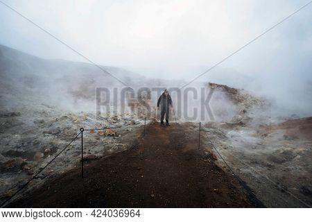 Male hiker at Landmannalaugar in the Fjallabak Nature Reserve, the Highlands of Iceland