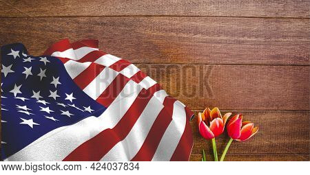 American flag and red tulip flowers on wooden background. american patriotism template background design concept