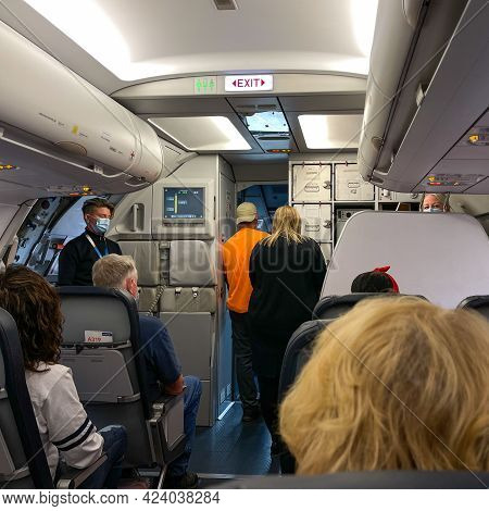 People Waiting In An Allegiant Airplane At The Sanford International Airport In Sanford, Florida Get