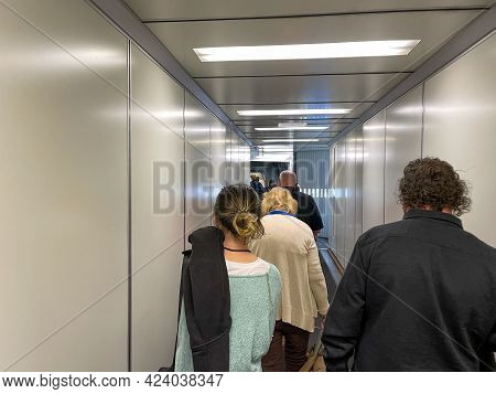 People Waiting In The Jetway To Board An Allegiant Airplane At The Sanford International Airport In