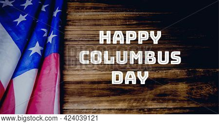 Happy columbus day text against american flag on wooden background. columbus day template background design concept