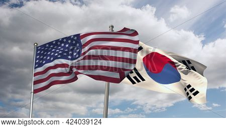 American and south korea flag waving against clouds in blue sky. international relations and affairs concept