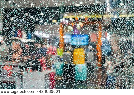 Cracked Glass. Broken Shop Window. Abstract Shattered Background.