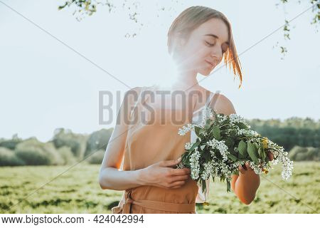 Young Girl Florist In Apron Is Creating A Floral Bouquet As A Gift From Blooming Wildflowers. Floris
