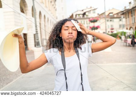Black Woman Suffering And Sweating For Hot Weather