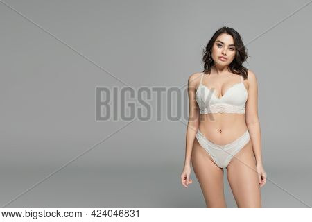 Sexy Woman In Lace Bra And Panties Posing Isolated On Grey
