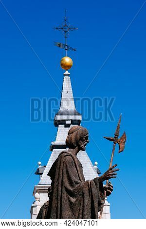 Madrid, Spain - March 20, 2021: Bronze Sculpture Of Apostle At The Rooftop Of Almudena Catheral In M