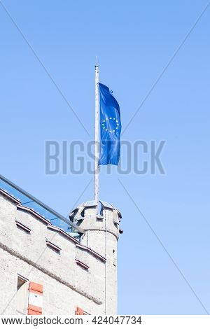 European Union Flag.  The Flag Of The European Union Flies From The Top Of A Building.