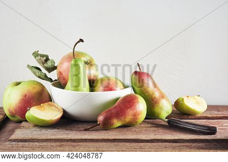 Ripe Organic Apples And Pears On A Wooden Table, Still Life.