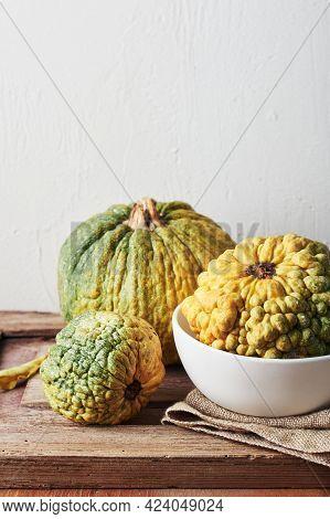 Yellow Decorative Pumpkins On A Wooden Table, Autumn Still Life.