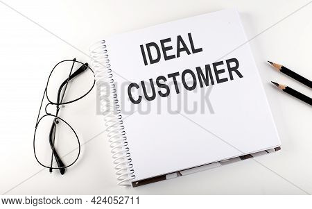 Notepad With Text Ideal Customer . White Background. Business