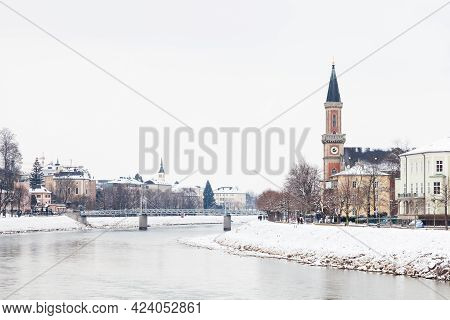 A Mid Winter View Along The Salzach River In Salzburg, Austria Looking Towards The Protestant Parish