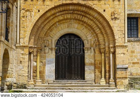 Arched Main Door, Entrance To An Old Romanesque Church In Northern Spain. Santillana Del Mar, Cantab