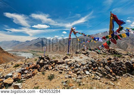 Buddhist prayer flags lungta with Om mani padme hum mantra written on them in Spiti Valley in Himalayas, Himachal Pradesh, India