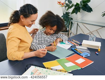 African American Girl With Autistic Disorder With Childs Psychologist While Psychological Treatments