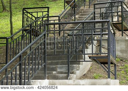 Iron Stairs In The City Park. Stairs Lit By The Morning Sun.