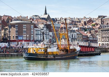 Whitby, England - June 25:  The Fishing Boat, Trevessa Iv Departs The Seaside Town Of Whitby In York