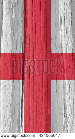 Fragment Of The Flag Of England On Dry Wooden Surface, Cracked With Age. It Seems To Flutter In The
