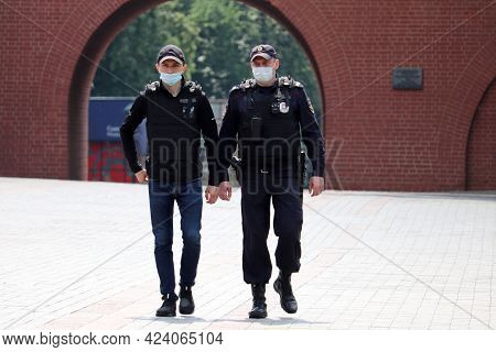 Moscow, Russia - June 2021: Two Russian Police Officers In Face Masks And Bulletproof Vest Patrol Th