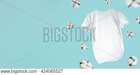 White Flying Cotton T-shirt Isolated On Turquoise Background. White T-shirt For Women Or Men. Unisex