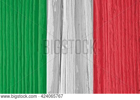 The Flag Of Italy On Dry Wooden Surface, Cracked With Age. It Seems To Flutter In The Wind. Backgrou