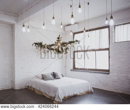 Christmas Cozy Winter Home Decor. Christmas Interior Decoration. Bed With White Linens, Blanket, Pil