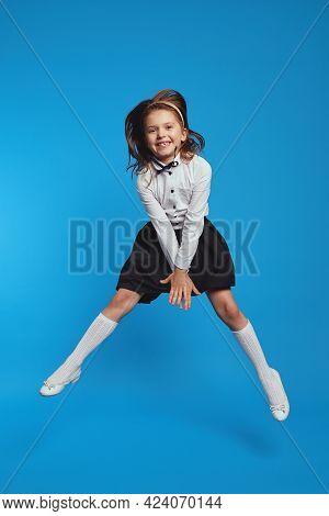 Little Pupil Jumping High, Finally Holidays Wears School Uniform