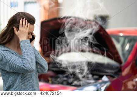 Woman Talking To Reliable Car Mechanic. Breakdown And Crash