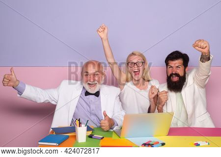 Excited Businesspeople. Business Winners. Group Of Happy Business People Looking At The Laptop And G