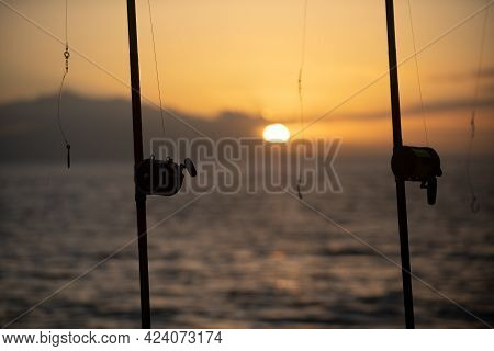 Fishing Rods Held In Fishing Rod Holders. The Rods Are Bent From The Weight Of The Down Riggers. Tro